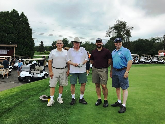 group of guys ready to golf
