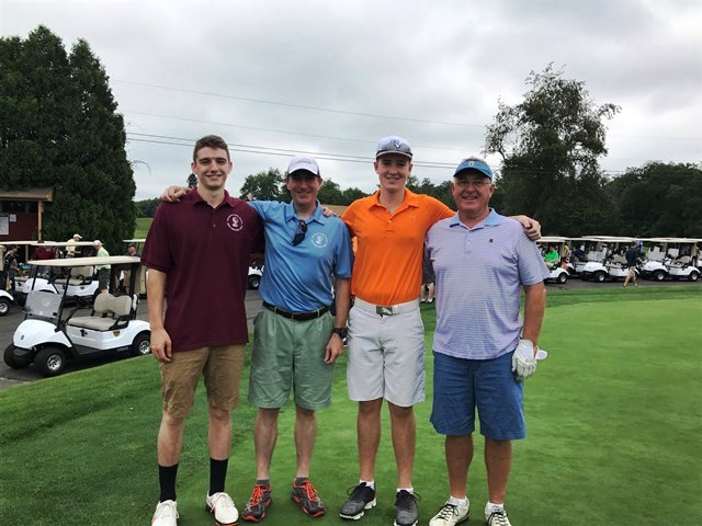 golfers on green